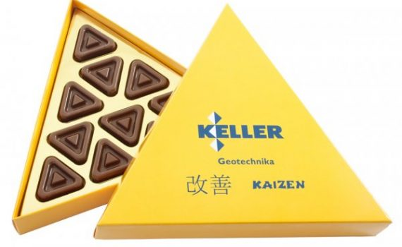 11 triangular chocolates in cardboard boxes